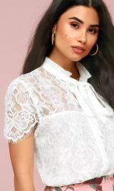 SOPHIA WHITE LACE TIE-NECK TOP $49 - https://www.lulus.com/products/sophia-white-lace-tie-neck-top/605162.html